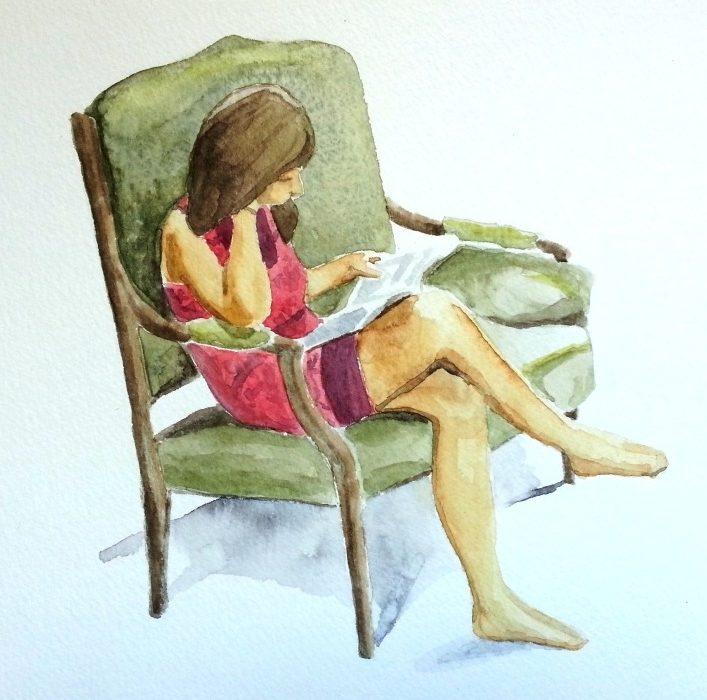 Jeune fille assise en train de lire