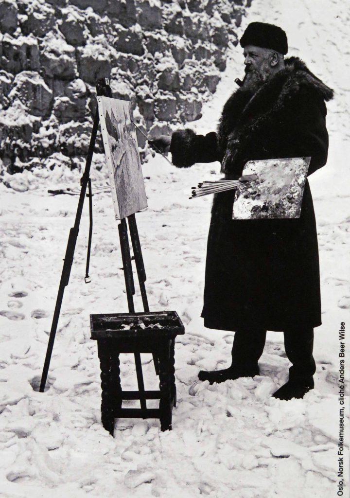 Photo de Frits Thaulow peignant en extérieur, dans la neige